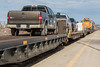 Flat cars for vehicles (chain cars) behind GP38-2 locomotives 1804 and 1808 in Cochrane.