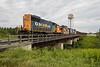 Rock train behind GP38-2 1808 departing Moosonee long hood forward.