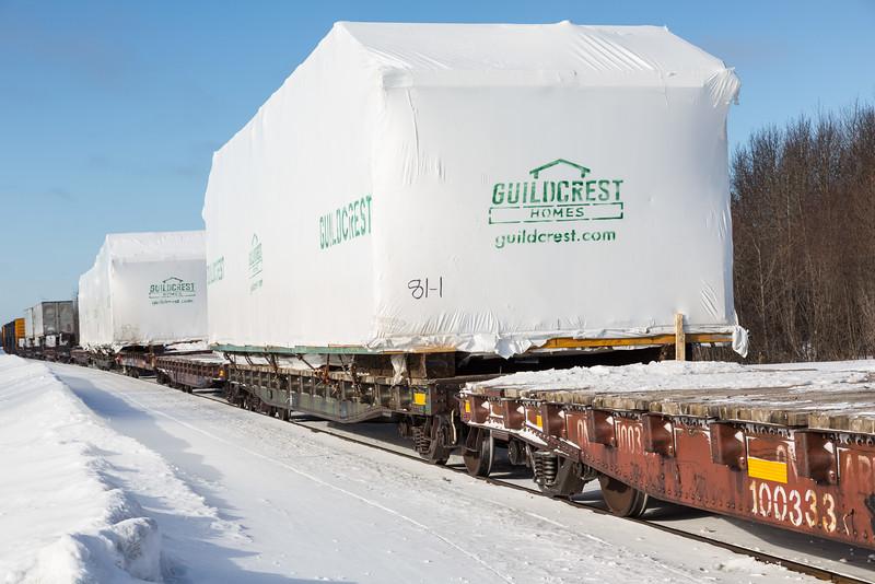 Prefab homes by Guildcrest destined for Attawapiskat arrive in Moosonee on freight 419.