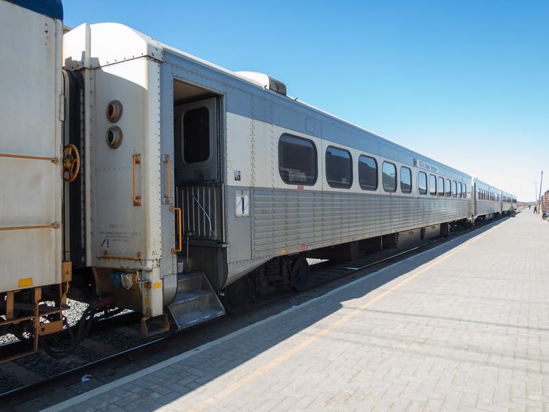 Polar Bear Express passenger consist: coach 604, snack 702, coaches 603 and 615.