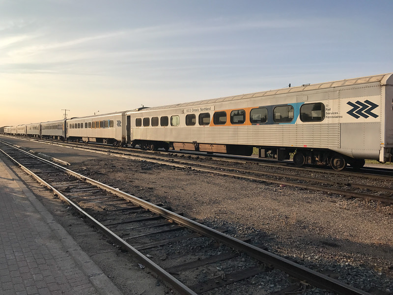Passenger consist of the Polar Bear Express on third track from platform in Cochrane