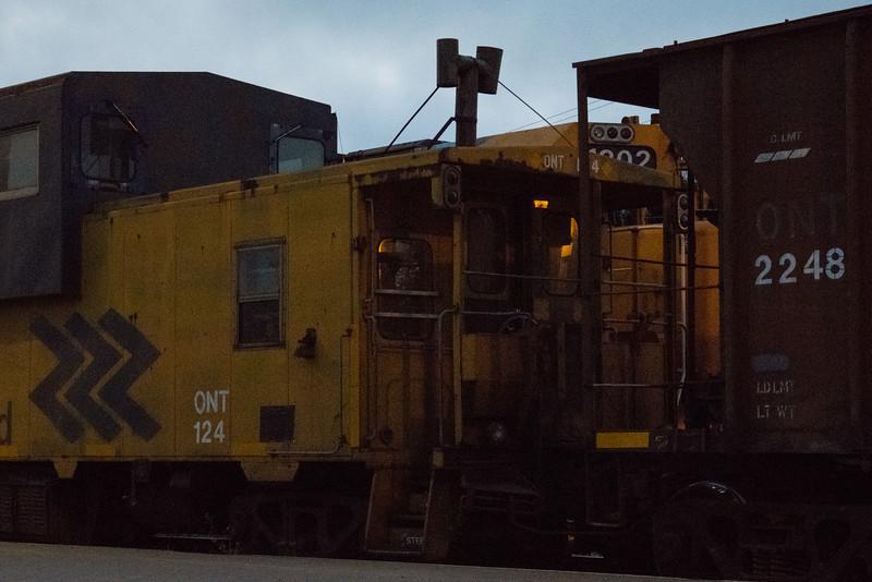Rock (ballast) train in Moosonee. Caboose 124, hopper ONT 2248, GP38-2 1802 on next track.
