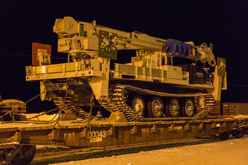 Flatcar ONT 100343 loaded with Powertel drill on Revillon Road in Moosonee.