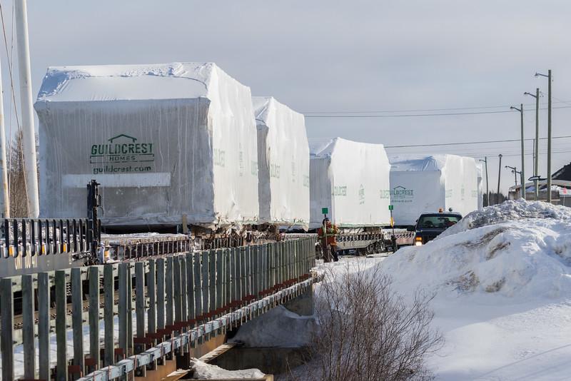 Freight 419 crossing Store Creek. Prefab houses destined for Attawapiskat.