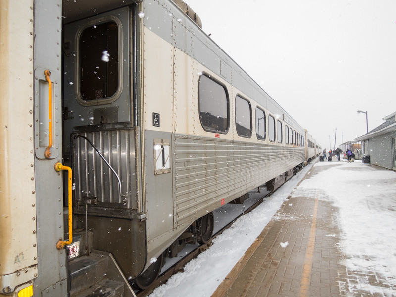Polar BEar Express passenger coaches in Moosonee with light blowing snow.