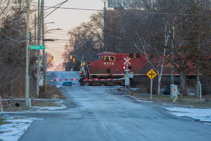 ES44AC locomotive CP 8772 leads a container train across Herchimer Avenue in Belleville Ontario just before sunrise.