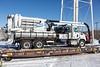 Vacuum truck on board flatcar 100311.