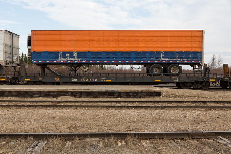 Flatcar 100412 with chevrons.