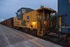 Ontario Northland Railway caboose 124 in Moosonee in ballast train.