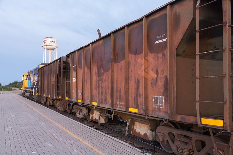 Ontario Northland Railway ballast train in Moosonee behind GP40-2 2202.