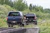 Two hirail trucks coming onto Store Creek Bridge.