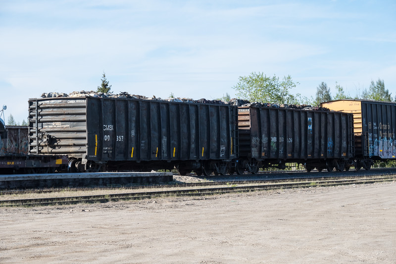 Two hoppers with scrap at Moosonee train station.