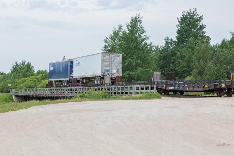 Tail end of freight 419 crossing Store Creek in Moosonee. Flatcar 100402 closest.