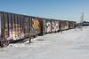 Freight 419 heads into Moosonee. Boxcars following gondolas.