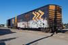 Ontario Northland Railway boxcars 2707 and 7700 along Revillon Road at barge docks in Moosonee.