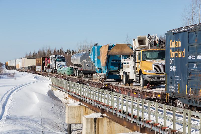 On railway bridge across Store Creek freight 419 showing heavy equipment. Box 2708.