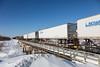 Trailers on flatcars in the consist of freight 419 crossing Store Creek in Moosonee.