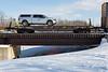 Flatcar 100500 crossing Store Creek in Moosonee.