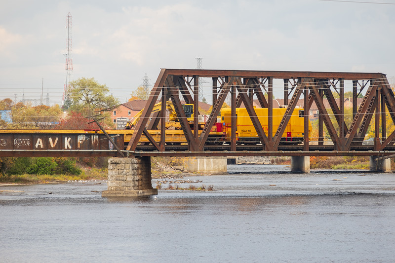 Herzog Railway Services HZGX 1690 crossing the Moira River on Canadian National Railways tracks