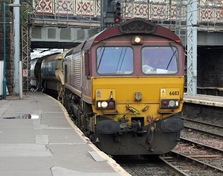 66113 enters Carlisle Station with empty ballast hoppers on Monday 12th August 2013