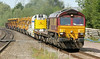 66087 with the Bescot to Toton engineers with load including a Kirow crane and empty point carriers at  Water Orton on Monday 11th August 2014