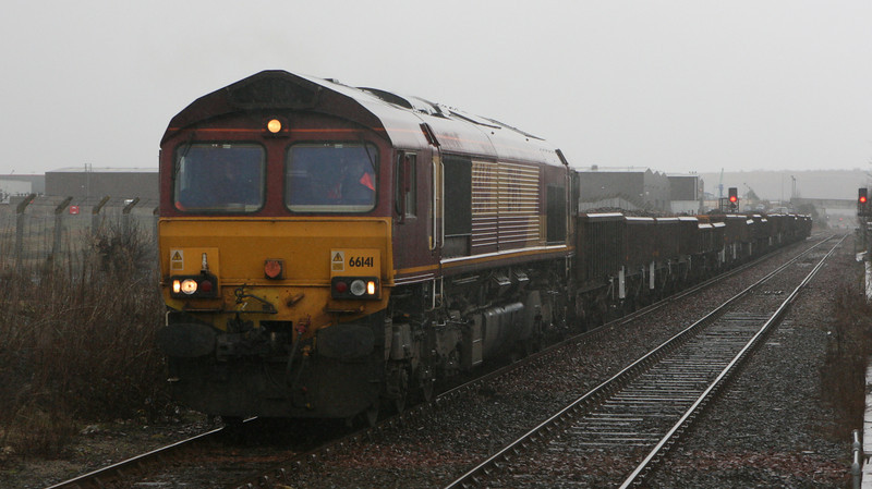 66141 returns south through Dyce in wind and rain with ballast wagons which had been sitting at Raith's Farm since January's engineering work at Newtonhill.
