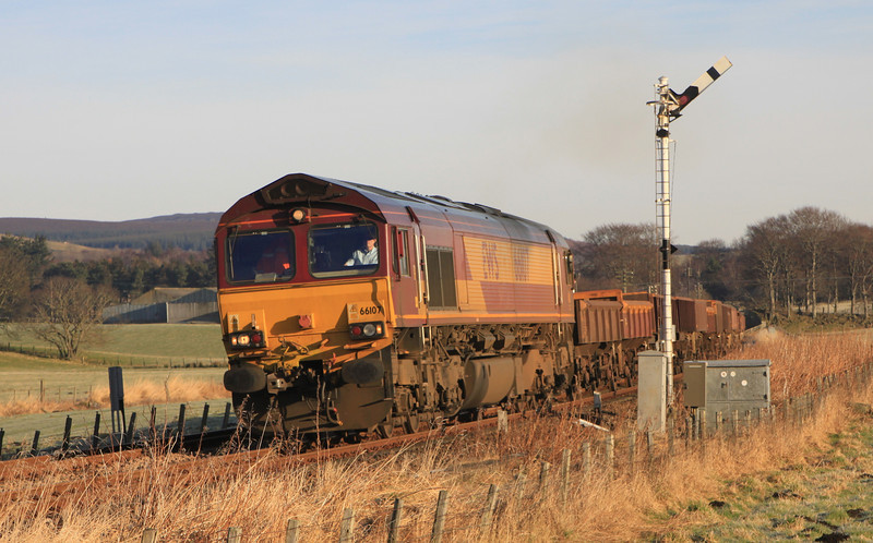 66107 with engineering train moves off after a signal check at Kennethmont on 15th January 2012
