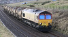 66084 runs past Burnhaven on the approach to Aberdeen with china clay empties on 21st January 2012
