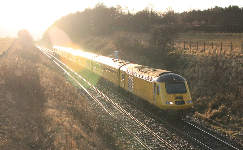 The NMT comes out of the sun on the approach to Laurencekirk on 21st January 2012