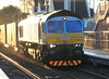 66434 with Malcolm livery replacing the former Fastline colours races through Laurencekirk on 21st January 2012