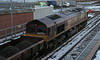 66170 sits in Laurencekirk Station on the 27th January 2013 with wagons of spoil from the work site at Marykirk