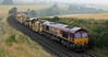 66107 heads out of Lunan Viaduct work site with 6K10 MOBC for Mossend at 06:39 on Sunday 5th Aug 2012 (66111 on rear)