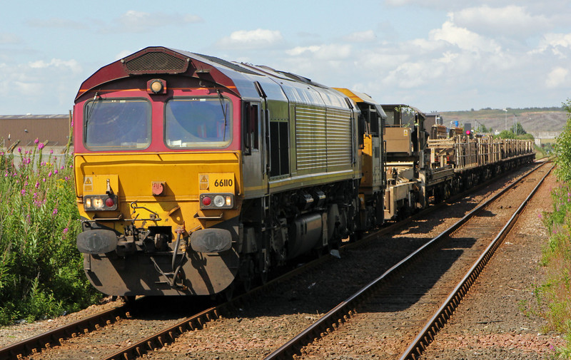 66110 heads into Dyce Station on the 3rd August 2012 with the 6K25 Raith's Farm to Carlisle CWR train after an overnight rail drop in the Huntly area