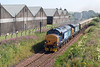 1Z72 Northern Belle roars past Chivas Brother's whisky warehouses in Keith on Saturday 20th July 2013