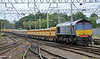 66304 enters Carlisle Station with loaded ballast hoppers on Monday 28th June 2015