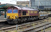 66144 side-tipping ballast hoppers heads south from Carlisle on Monday 28th June 2015