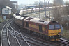 60065 Pride of Jaguar with empty coal hoppers having round in Latchford Sidings in Warrington on Saturday 17th March 2012