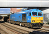 60074 Teenage Spirit runs west through Newport Station with empty steel wagons on Monday 19th March 2012