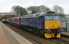 57605 Totnes Castle with Penzance sleeper at St Austell on 11th March 2013
