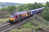 67004 climbs to Slochd summit with late running sleeper on 28th May 2011