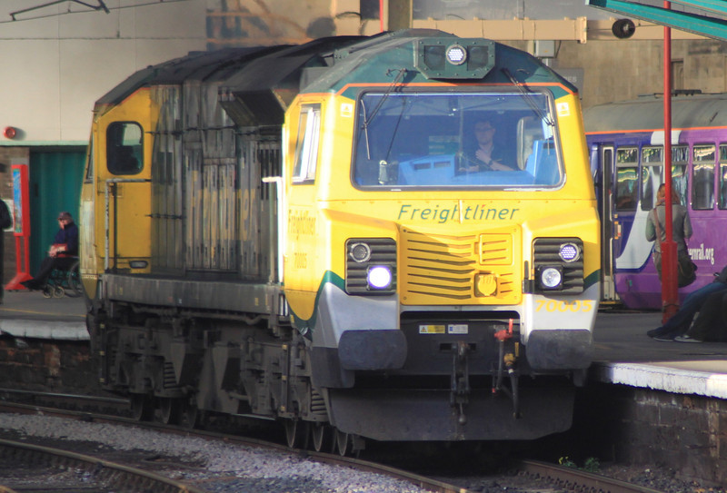 70005 heads south through Carlisle on 24th November 2011 after dropping off ballast hoppers