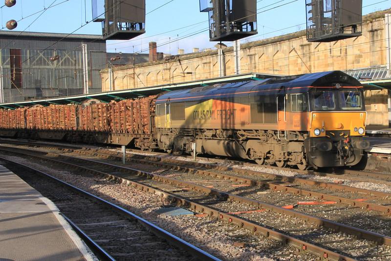 66848 takes log train south through Carlisle station before heading over Settle to Carlisle line on 25th November 2011