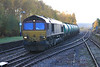 66114 arives in Dingwall with fuel tanks for Lairg on 5th November 2011