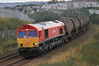 66101 heads south from Aberdeen with loaded china clay tanks in  fading light on 3rd September 2011