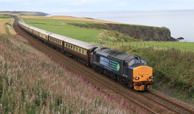 37423 heads final dining train south past Limpet Mill between Aberdeen and Stonehaven on 8th September 2011