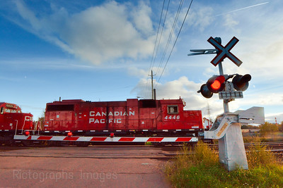 A Train Engine At A Crossing