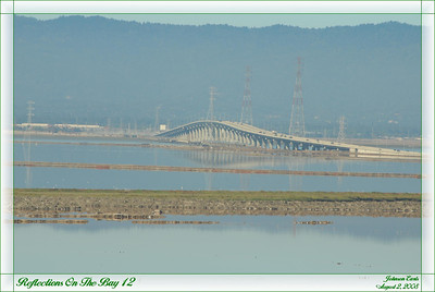 Reflections on the Bay 12  Dumbarton Bridge, as seen from the observation area in the Don Edwards San Francisco Bay Wildlife Refuge.  Don Edwards San Francisco Bay Wildlife Refuge, Fremont California, 2 August 2008