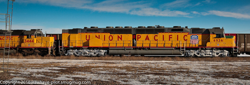 "The Union Pacific's last operating ""Centennial"" locomotive at work on a wintry day in Omaha, NE. Part of the UP's Heritage Fleet, this unit is so rarely seen pulling freight (at least by me) that this was the only time in many years that I was able to catch it!"
