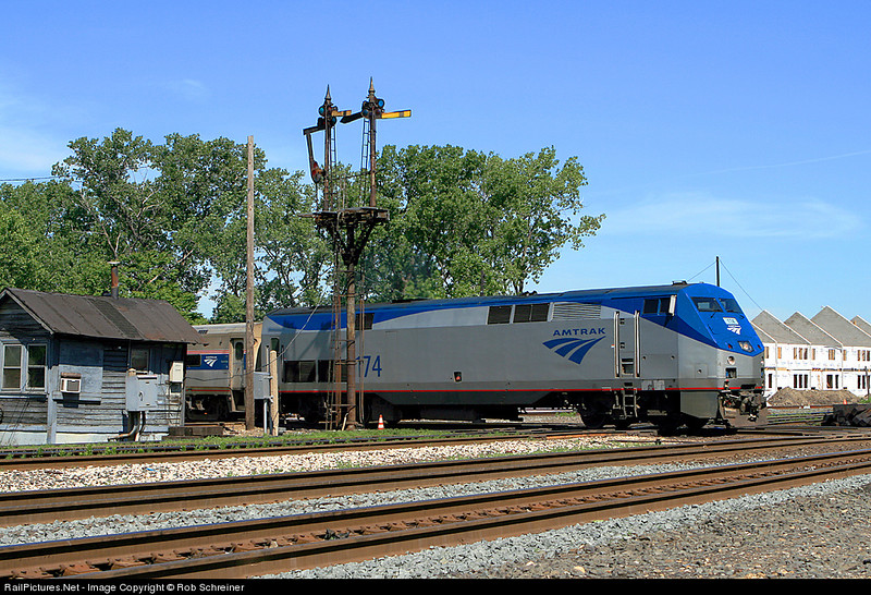 Amtrak passes the junction at Brighton Park in Chicago under the semaphore blades.