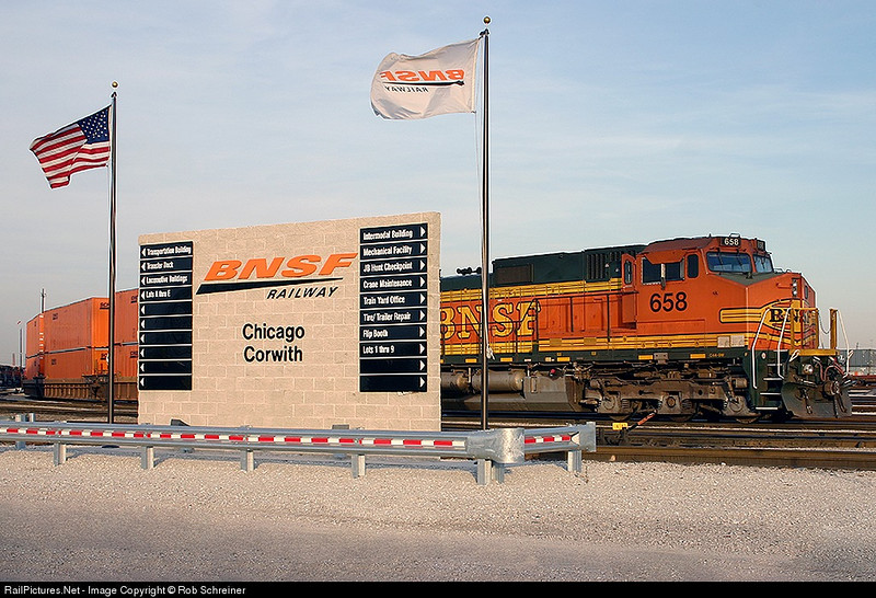 A BNSF locomotive is posed perfectly behind the directory sign at the Corwith yard in Chicago.